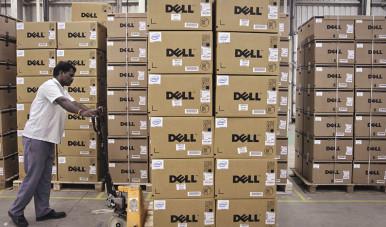 Imagem de galpão da Dell, com diversas caixas da marca.